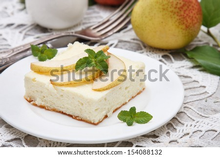 Cottage cheese souffle(casserole) with pear  - stock photo