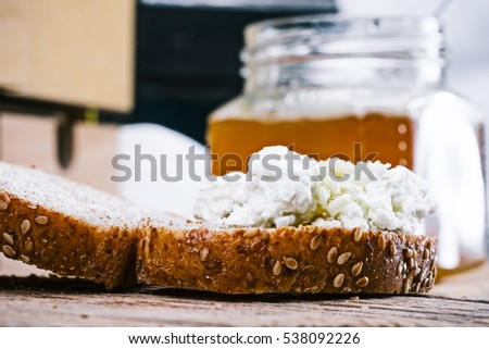 Cottage cheese with honey on toast. Concept of simple organic food