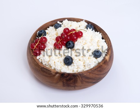 Cottage cheese with ripe blueberries and Red currant - stock photo