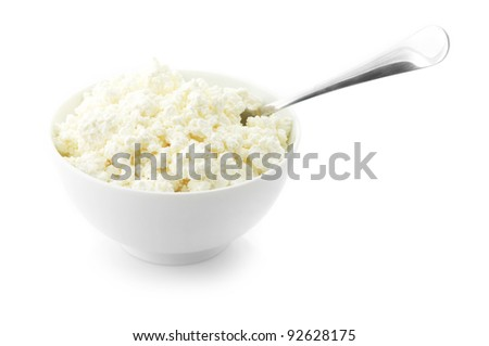 Cottage cheese with spoon in white bowl isolated on white background. - stock photo