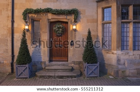 Cottage facade at Christmas, Chipping Campden at dawn, Gloucestershire, England