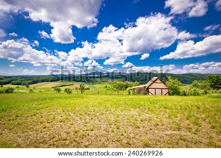 Cottage in idyllic agricultural landscape of Prigorje region in Croatia - stock photo