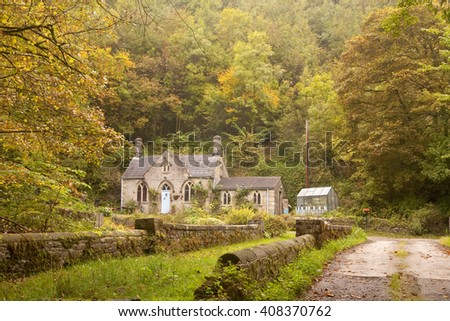 Cottage In The Woods A Heavily Wooded Hillside Is Slowly Turning To Colours Of