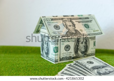 Cottage made of dollar banknotes, housing loan. Think green. - stock photo