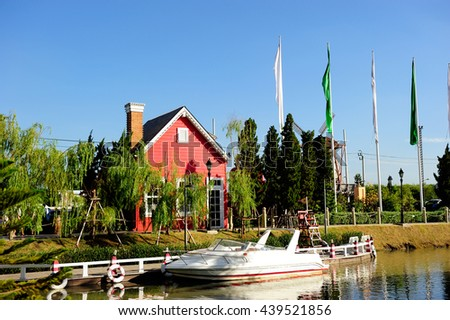 Cottage near the lake in Europe - stock photo
