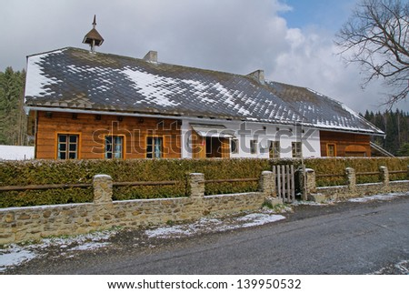 Cottage on a secluded slightly covered with snow