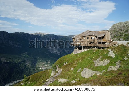 Cottage on the edge of rock wall in Lysefjord, Norway. - stock photo
