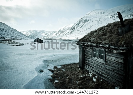Cottage on the ice desert in Norway - stock photo