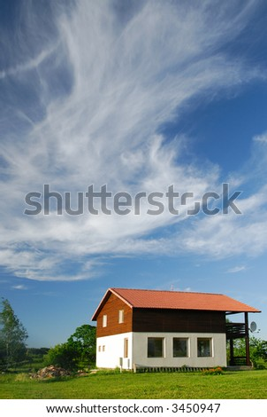 Cottage on the nature in the spring - stock photo