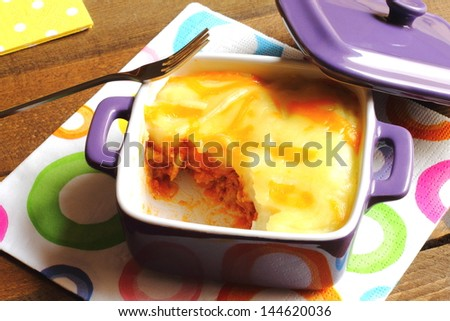 Cottage pie in a purple casserole - stock photo