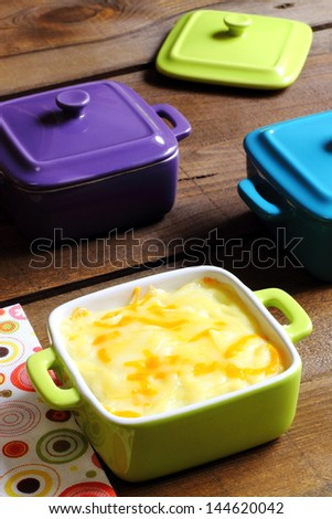 Cottage pie served in colorful casseroles - stock photo