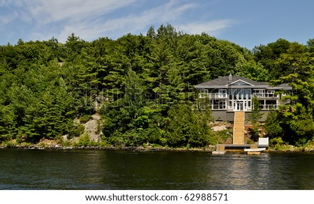 Cottage with a staircase to the dock