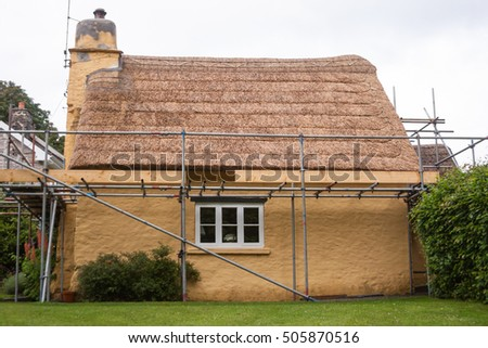 cottage with freshly thatched roof