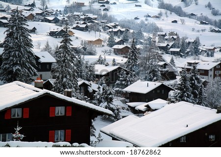 Cottages at the Swiss Alps of the Jungfrau region. - stock photo