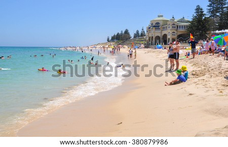 Cottesloe Beach scene with families in Western Australia/Family Swim/COTTESLOE,WA,AUSTRALIA-JANUARY 6,2016: Indiana Tea House, Indian Ocean and families at Cottesloe Beach, Cottesloe, Australia.