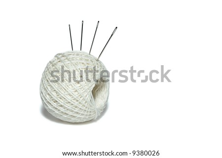 cotton clew with needles isolated on white background - stock photo
