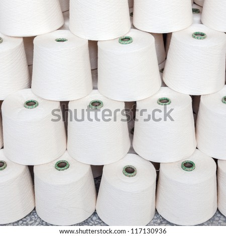 cotton cone stacked in a yarn factory - stock photo