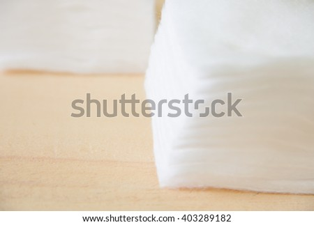 Cotton on wood table. - stock photo