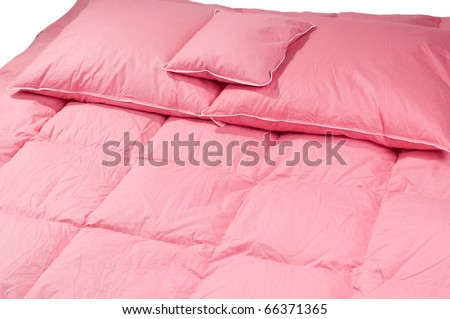 Cotton pink fluff pillows on duvet without cover, eiderdown filled with fluff or feathers. Horizontal orientation, nobody.