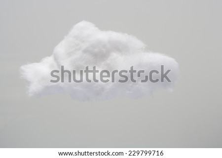 Cotton Wool Cloud isolated in Grey Background with Text Space. Clouds Made of Real Cotton - stock photo