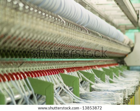 Cotton yarn production in a textile factory - stock photo