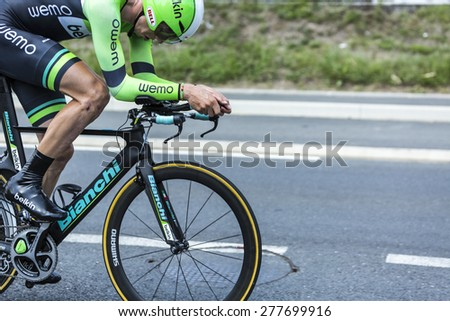 COULOUNIEIX-CHAMIERS,FRANCE-JUL26: Close up of the cyclist Sep Vanmarcke (Belkin Team) on a Bianchi bicycle pedaling during the stage 20 ( time trial Bergerac - Perigueux) of Le Tour de France 2014. - stock photo