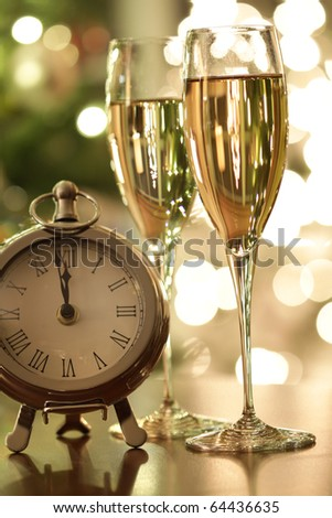 Countdown to New Years celebrations with champagne - stock photo