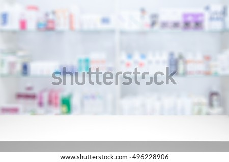 counter store table pharmacy background shelf blurred blur focus drug medical shop drugstore medication blank medicine pharmaceutics concept - stock image