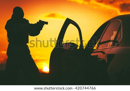 Counter Terrorism Check Point. Hunt For Terrorists. SWAT member in a Mask Pointing His Gun on Terrorist Member Inside Stopped Vehicle.  - stock photo