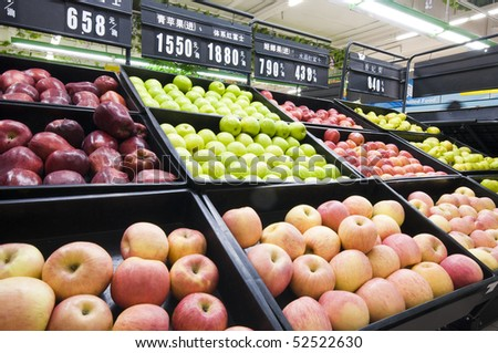 Counter with fruit in supermarket - stock photo