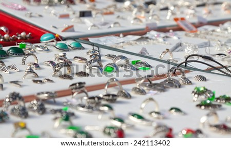 counter with silver jewelry at store  - stock photo