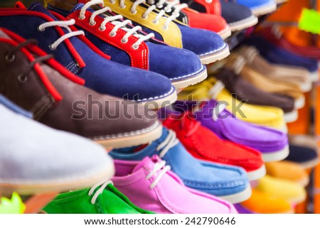 Counter with sport shoes at fashionable shop - stock photo