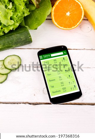 Counting calories in smartphone. Concept of app for healthcare - stock photo