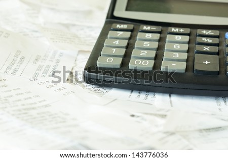 Counting the costs after shopping - stock photo