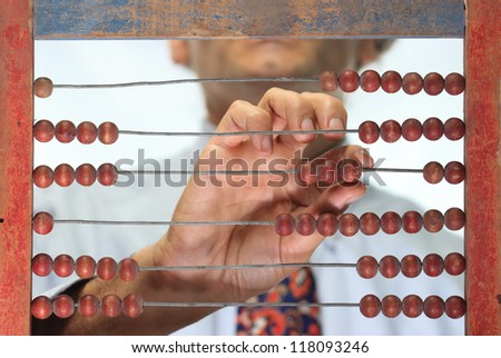 counting with an old wooden abacus - stock photo