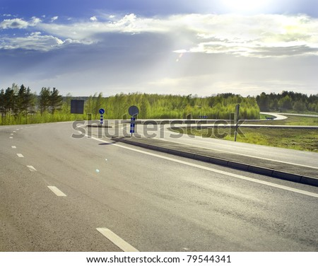 Country asphalt road on a sunny morning - stock photo