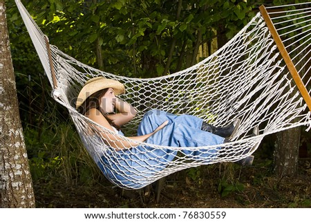 country girl resting on a hammock - stock photo