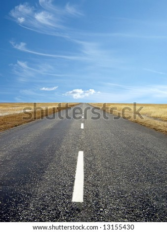 country highway with a beautiful blue sky