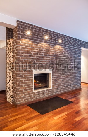 Country home - brick wall in modern house interior - stock photo