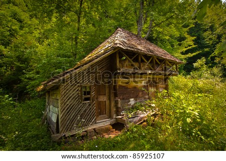 Country House abandoned in woods - stock photo