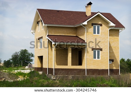 Country house of yellow brick. Construction completed - stock photo
