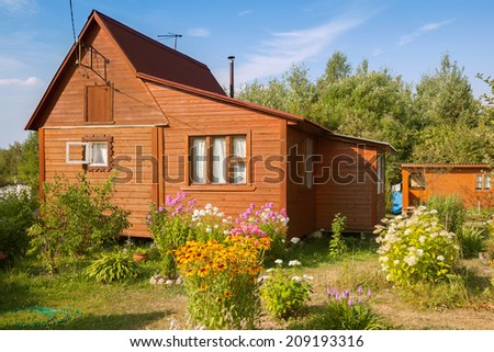 Country house with a plot of land - stock photo