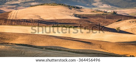 Country landscape of tuscan hills in the morning, Italy