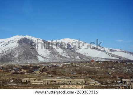 Country landscape with snowy mountains    - stock photo