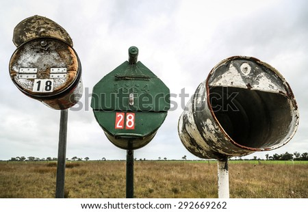 Country letterboxes in Australia, with paddock in the background.