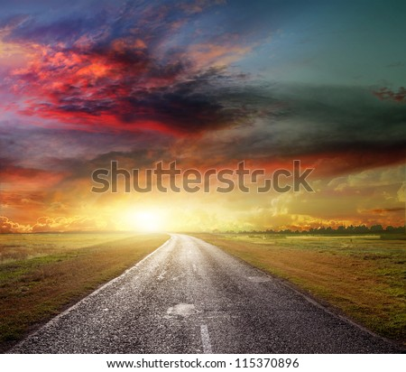 country road across the steppe - stock photo