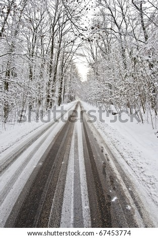 country road after heavy snowfall - stock photo
