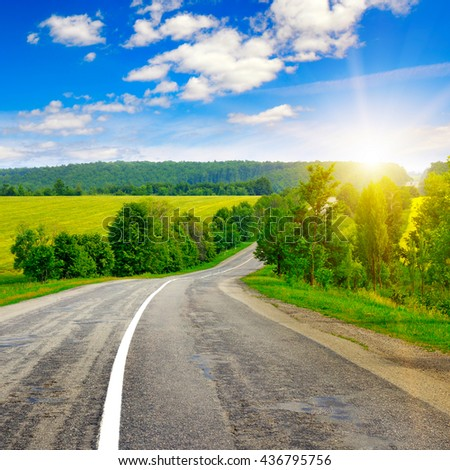 country road and beautiful sunset - stock photo