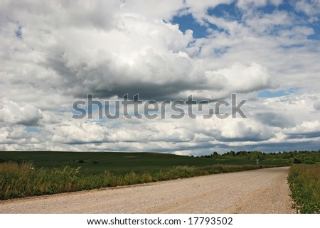 Country road and cloudy sky (Latvia)