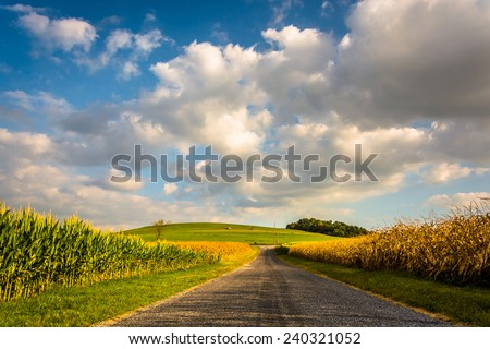 Country road and large hill, near Spring Grove, Pennsylvania. - stock photo